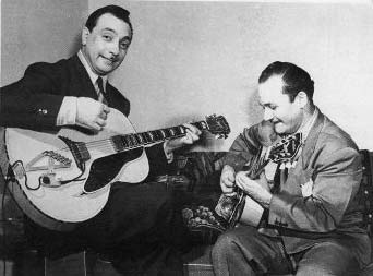 Django Reinhardt playing guitar during his tour with Duke Ellington