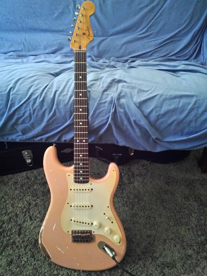 The Difference Between Fender Stratocaster and Telecaster-pink-relic-strat-jpg