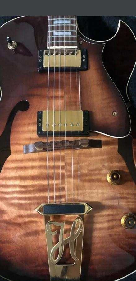 Is it normal for guitar bridge to be crooked?-guitar-jpg