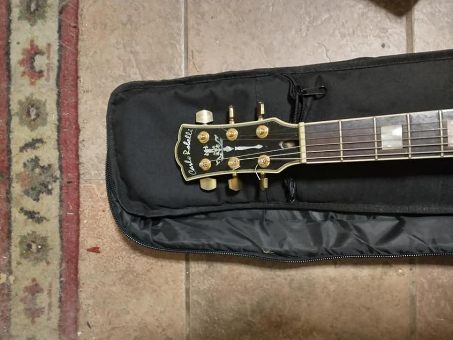 Found an oddball at the pawn shop-683203492_carlorobelliheadstock-jpg-5d24d2c79d3b3a79f549bd360380c321-jpg