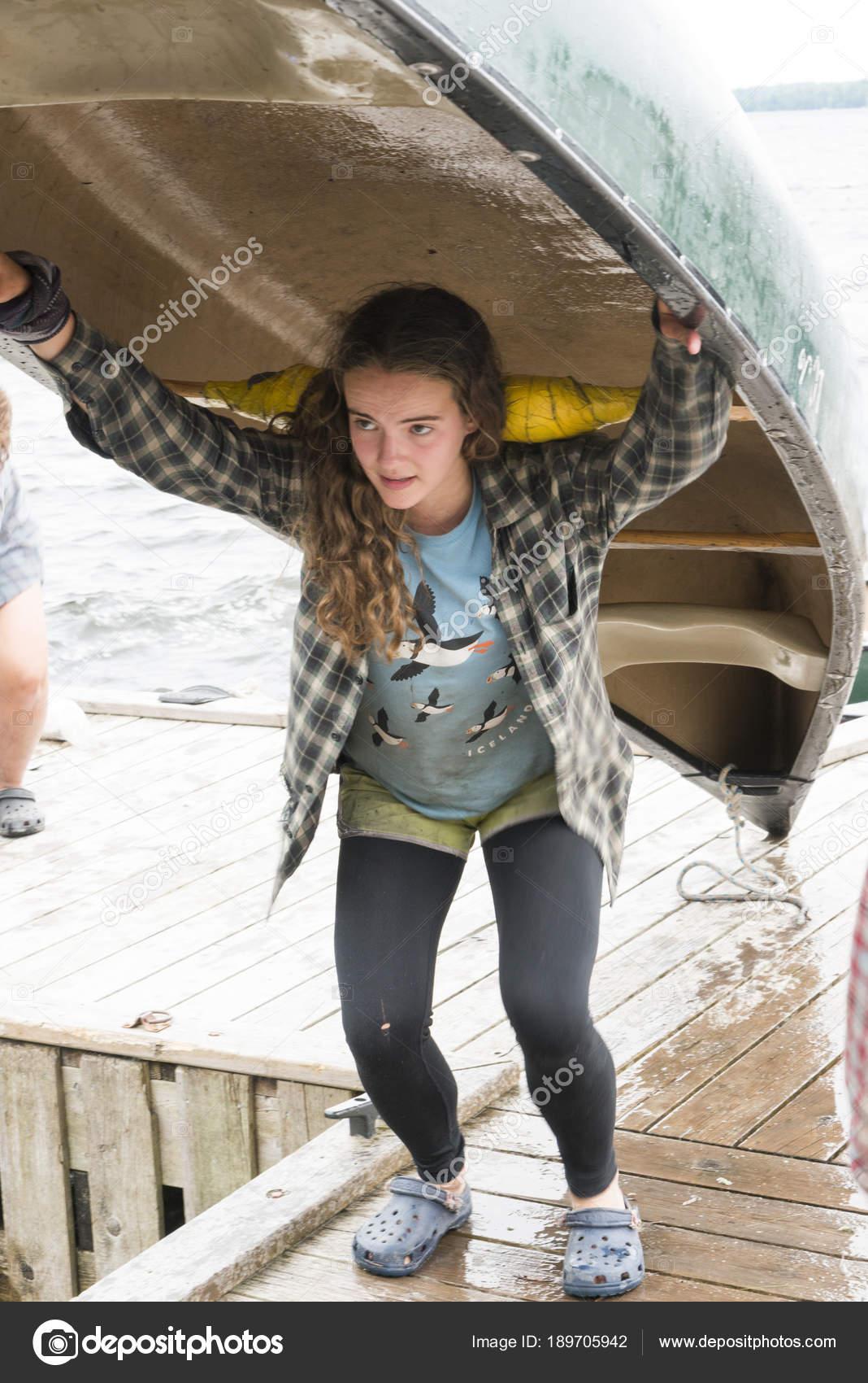 Buyer, seller, or holder?-teenage-girl-carrying-canoe-her-jpg