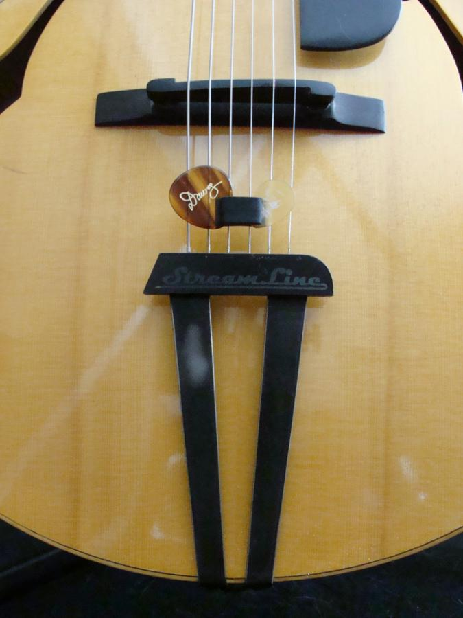 Fingerpicking with pick in hand-wedgie-holder-jpg