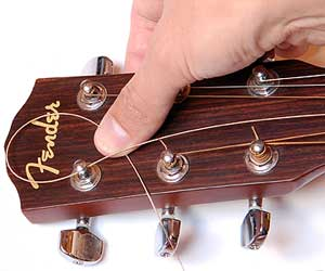 how to string a guitar replacing guitar strings. Black Bedroom Furniture Sets. Home Design Ideas